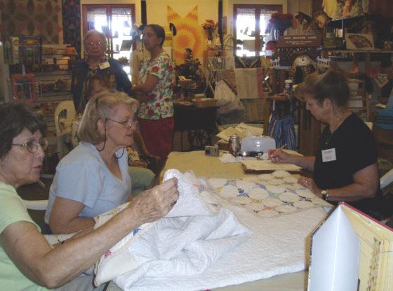 Dawn Licker appraises quilts